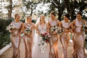 bride and bridesmaids walking and laughing bridal tips