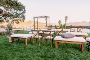 wedding trends beautiful alternative outdoor wedding ceremony seating with wooden pallet benches and pillows
