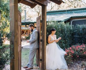 bride and groom shares a private moment reading their vows