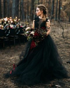 Black is back wedding trend wedding dress with black and burgundy decor and flowers