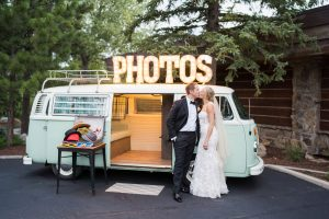 newly wed couple standing in front of combi Photo Booth